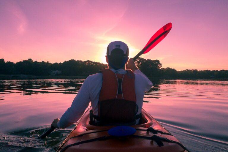 Man kayaking during sunset